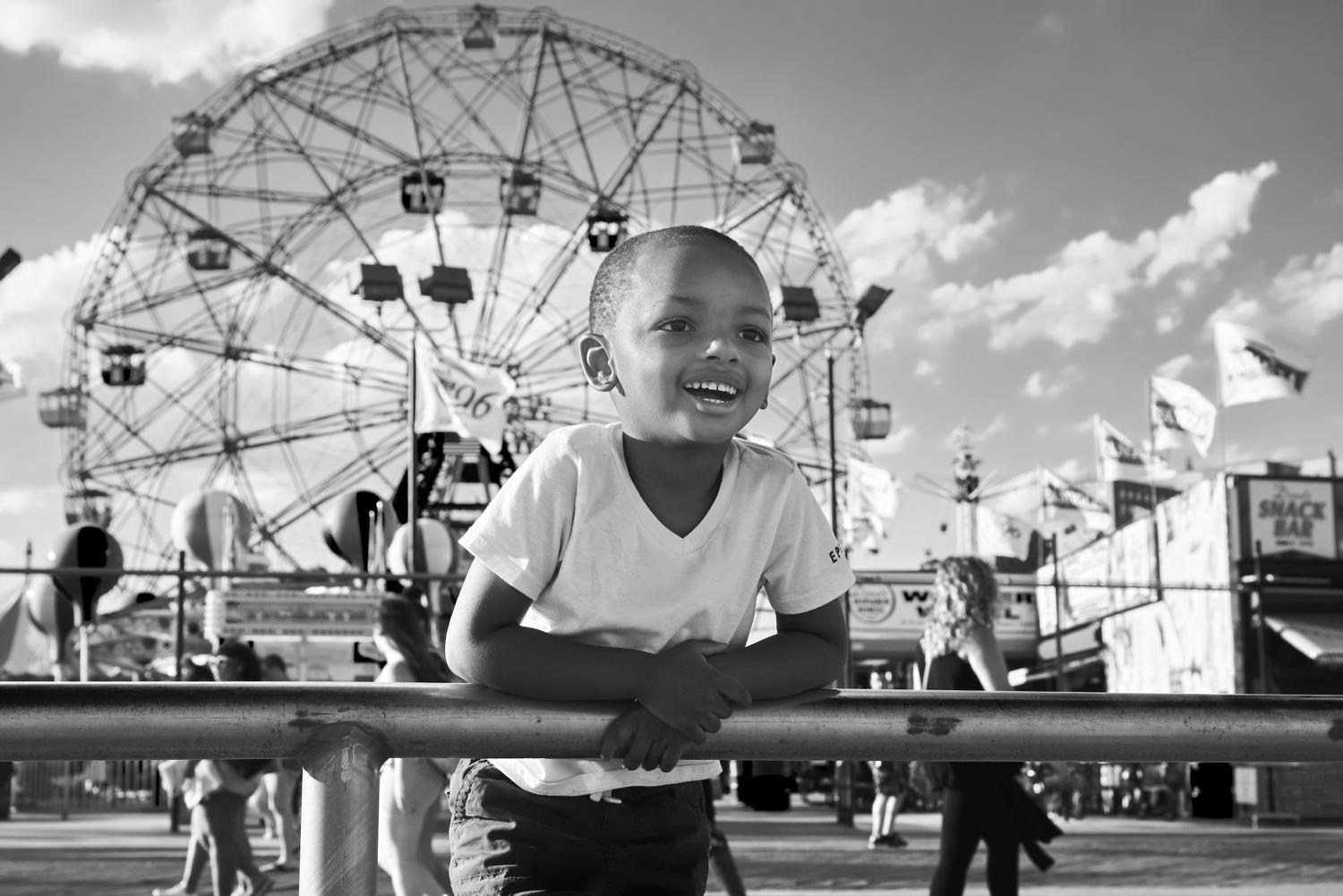 Young boy enjoys Coney Island. Photopgraph by Joel Davidson.