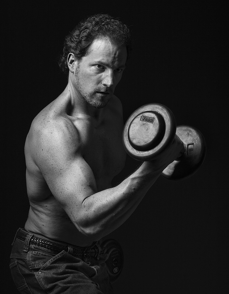 Dave Barnas, author from True Health Unlimited, attempting to build some biceps.